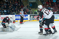 KELOWNA, CANADA - DECEMBER 5: Jackson Whistle #1 of Kelowna Rockets makes a save from a shot by Aaron Macklin #17 of the Prince George Cougars on December 5, 2014 at Prospera Place in Kelowna, British Columbia, Canada.  (Photo by Marissa Baecker/Shoot the Breeze)  *** Local Caption *** Jackson Whistle; Aaron Macklin;