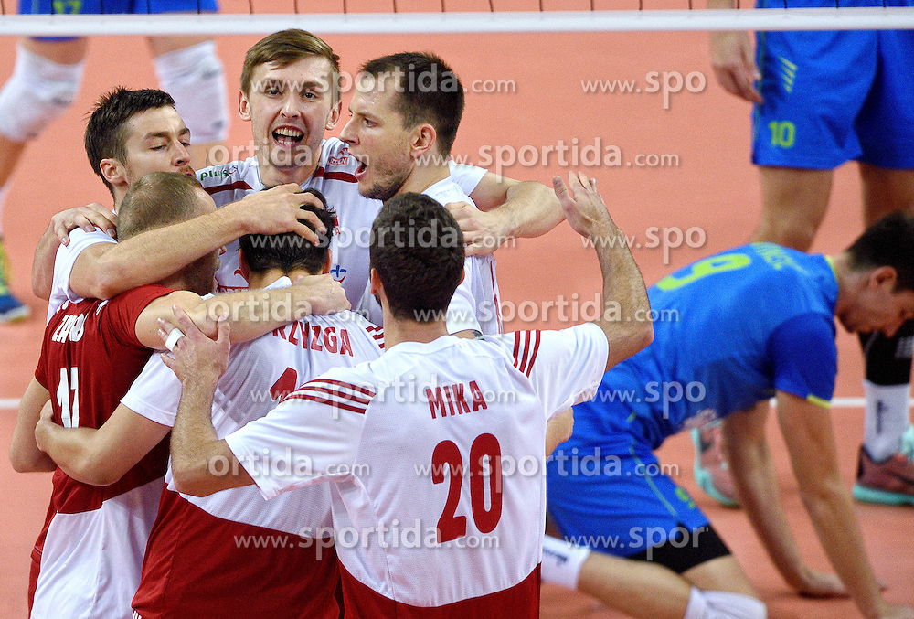 Mateusz Bieniek #9, Bartosz Kurek #6, Mateusz Mika #20 during volleyball match between National teams of Poland and Slovenia in Quarterfinals of 2015 CEV Volleyball European Championship - Men, on October 14, 2015 in Arena Armeec, Sofia, Bulgaria. Photo by Ronald Hoogendoorn / Sportida