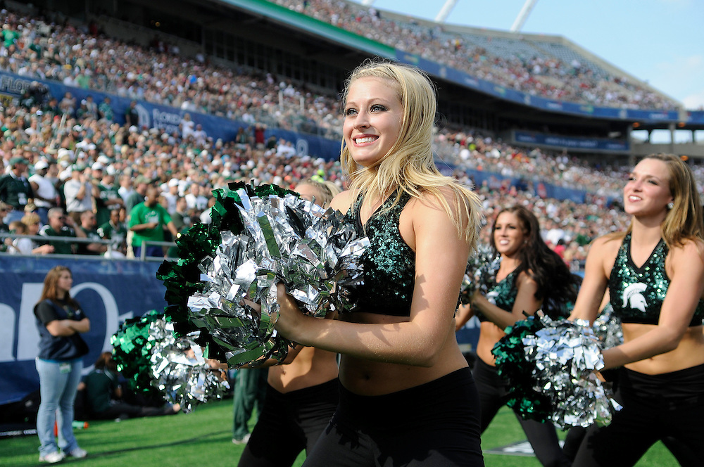 January 1, 2011: A Michigan State Spartans Cheerleader in action during the NCAA football game between Michigan State Spartans and the Alabama Crimson Tide at the 2011 Capital One Bowl in Orlando, Florida. Alabama defeated Michigan State 49-7.