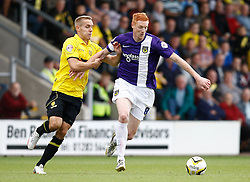 Oxford United's Dave Kitson tussles with Burton Albion's Chris Hussey  - Photo mandatory by-line: Matt Bunn/JMP - Tel: Mobile: 07966 386802 07/09/2013 - SPORT - FOOTBALL -  Pirelli Stadium - Burton upon Trent - Burton Albion V Oxford United - Sky Bet League Two
