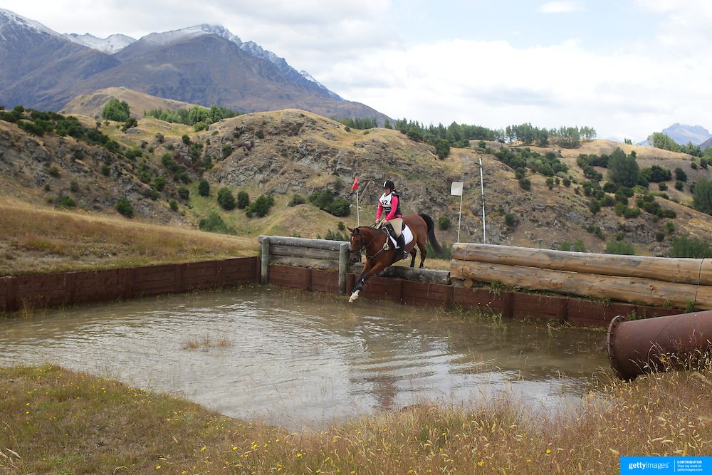 Michelle Harrex riding Just a Diamond in action at the water jump during the Cross Country event at the Wakatipu One Day Horse Trials at the Pony Club grounds,  Queenstown, Otago, New Zealand. 15th January 2012. Photo Tim Clayton