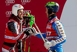 Second placed Nolan Kasper of USA and second placed Axel Baeck of Sweden celebrate during flower ceremony after the Men's Slalom of FIS Ski World Cup Alpine Kranjska Gora, on March 6, 2011 in Vitranc/Podkoren, Kranjska Gora, Slovenia.  (Photo By Vid Ponikvar / Sportida.com)