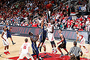 LOUISVILLE, KY - JANUARY 28: Gorgui Dieng #10 of the Louisville Cardinals blocks a shot by Trey Zeigler #23 of the Pittsburgh Panthers during the game at KFC Yum! Center on January 28, 2013 in Louisville, Kentucky. Louisville defeated Pitt 64-61. (Photo by Joe Robbins)