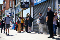 © Licensed to London News Pictures. 01/06/2020. London, UK. Members of public observe social distancing queuing outside Nationwide Building Society in Wood Green, north London as lockdown restrictions are eased in England after ten weeks of the coronavirus lockdown. Photo credit: Dinendra Haria/LNP