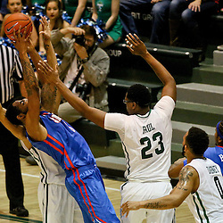 Jan 17, 2016; New Orleans, LA, USA; Southern Methodist Mustangs forward Markus Kennedy (5) shoots over Tulane Green Wave forward Blake Paul (23) and guard Malik Morgan (13)  during the second half of a game at the Devlin Fieldhouse. Southern Methodist defeated Tulane 60-45. Mandatory Credit: Derick E. Hingle-USA TODAY Sports