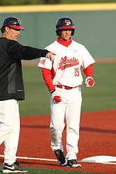 21 April 2015:  Bo Durkac gives some direction to Jared Hendren when he arrives at 3rd base during an NCAA Inter-Division Baseball game between the Illinois Wesleyan Titans and the Illinois State Redbirds in Duffy Bass Field, Normal IL