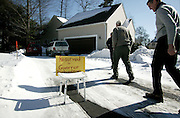 People pass a reserved parking sign on their way to a house party being held for presidential hopeful New Mexico Governor Bill Richardson in Hampton, N.H. Saturday February 17, 2007. (AP Photo/Cheryl Senter)