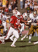 PALO ALTO, CA -  OCTOBER 18:  Darrin Nelson #31 of the Stanford Cardinal runs for yardage during a PAC-10 NCAA football game against the University of Washington Huskies played on October 18, 1980 at Stanford Stadium in Palo Alto, California. (Photo by David Madison/Getty Images) *** Local Caption *** Darrin Nelson