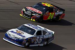 Mar 11, 2012; Las Vegas, NV, USA;  Sprint Cup Series driver Mark Martin (55) and driver Jeff Gordon (24) during the Kobalt Tools 400 at Las Vegas Motor Speedway. Mandatory Credit: Jason O. Watson-US PRESSWIRE
