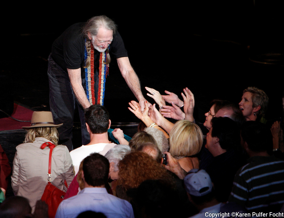 "January 13, 2012 - Willie Nelson greets his fans at a packed-house performance in Tunica at Gold Strike Casino Friday night. Willie is now 78 and is ""on the road again.""  Photo by Karen Pulfer Focht  (© Karen Pulfer Focht)"