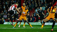 Konstantin Kerschbaumer of Brentford shoots during the Sky Bet Championship match between Brentford and Hull City at Griffin Park, London<br /> Picture by Mark D Fuller/Focus Images Ltd +44 7774 216216<br /> 03/11/2015