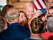 "16 JULY 2019 - MANNING, IOWA: Former Vice President JOE BIDEN poses for selfies on the ""rope line"" after a campaign event in western Iowa. Vice President Biden spoke to a crowd of about 250 people in Manning Tuesday morning. Biden is running to be the Democratic nominee for President in 2020. Iowa holds the first selection event of the 2020 election cycle. The Iowa Caucuses are on February 3, 2020.        PHOTO BY JACK KURTZ"