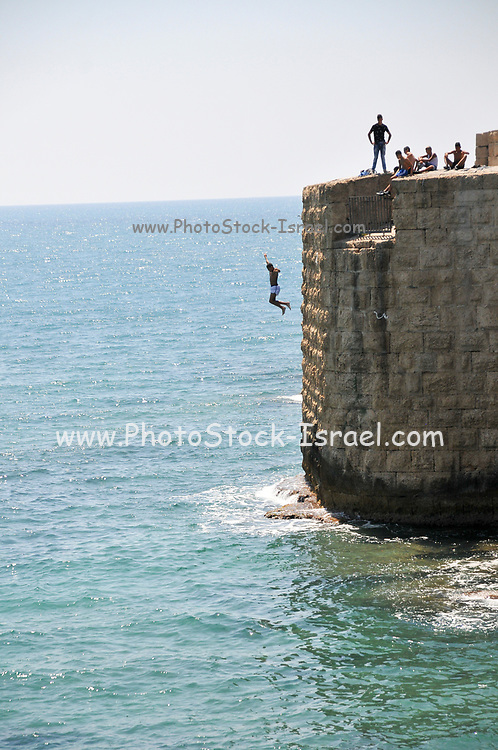 Israel, Acre, teen jumps off the walls of the old city into the Mediterranean sea