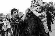 Violent clashes between pro and anti Mubarak in Cairo. Anti Egyptian president demonstrators repel Mubarak's supporters after they pushed aggressively inside Tahrir Square, the center of anti-government demonstrations,  hurling stones at each others. A wounded protester is helped out to a field clinic. 02 February 2011.