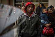 10 years ago, on 27 October 2005, riots broke out in the French suburbs. A boy in La Courneuve  watches the crowd during a visit of President Francois Hollande, who  was greeted with boos. La Courneuve is 5 km from Paris.  20 October 2015, La Courneuve, France.