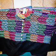 Examples of traditional weaving on display at Casa del Tejido Antiguo, an indigenous textile museum and market in Antigua, Guatemala