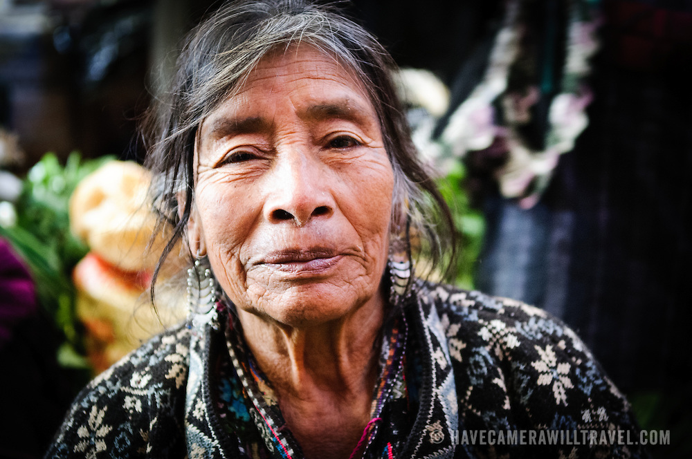 A Maya woman poses for a photo at the Chichi market. Chichicastenango is an indigenous Maya town in the Guatemalan highlands about 90 miles northwest of Guatemala City and at an elevation of nearly 6,500 feet. It is most famous for its markets on Sundays and Thursdays.