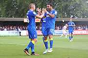 AFC Wimbledon striker Andy Barcham (17) and AFC Wimbledon midfielder Dean Parrett (18) celebrate during the EFL Sky Bet League 1 match between AFC Wimbledon and Gillingham at the Cherry Red Records Stadium, Kingston, England on 1 October 2016. Photo by Stuart Butcher.