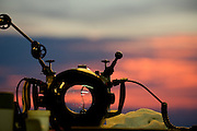 An underwater camera housing dries on a camera table at sunset aboard a liveaboard dive boat.