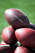 NFL footballs are piled up on the sideline before the Los Angeles Rams 2016 NFL preseason football game against the Dallas Cowboys on Saturday, Aug. 13, 2016 in Los Angeles. The Rams won the game 28-24. (©Paul Anthony Spinelli)