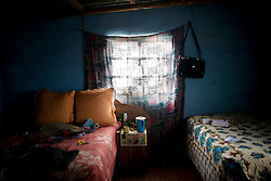 The bedroom of Somisewu Mookozo, 48, who left his job at a gold mine in 2007, after 16 years of work, because a medical exam showed he had contracted Tuberculosis.  He began a 6 month treatment plan but stopped when he said he started feeling better.  South African Gold miners are particularly vulnerable to contracting TB because of the small, poorly ventilated work conditions, high rates of TB and high rates of silicosis, a lung disease often found in miners that increases the chance of catching TB.