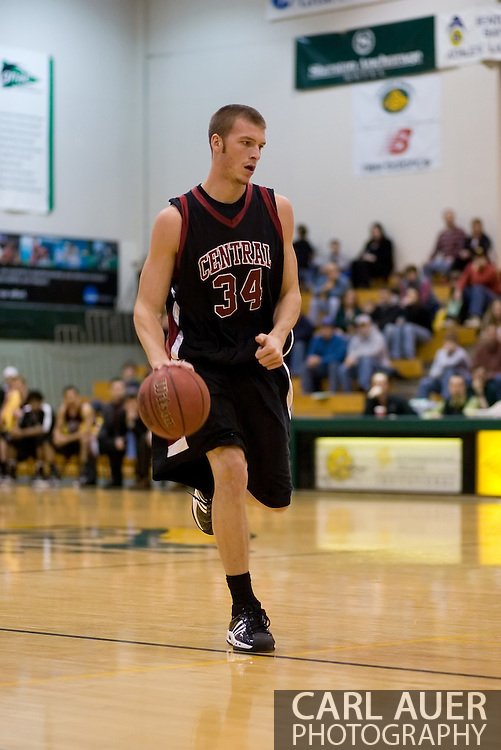 1/6/2006: Bryce Daub of the Central Washington Wildcats brings the ball up the court in the 60-80 loss to the University of Alaska-Anchorage at the Wells Fargo Sports Complex on the campus of UAA.<br />