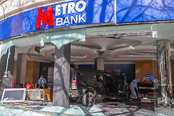 © Licensed to London News Pictures. 16/03/2020. London, UK. Forensic Officers work near a Land Rover Discovery in a branch of Metro Bank on the Kings Road in Chelsea after a vehicle was reportedly driven into the bank . Photo credit: George Cracknell Wright/LNP