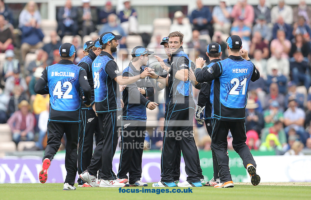 Tim Southee ( 3rd R ) of New Zealand celebrates after taking the wicket of Jason Roy ( not pictured ) during the Royal London One Day Series match at the Ageas Bowl, West End<br /> Picture by Paul Terry/Focus Images Ltd +44 7545 642257<br /> 14/06/2015