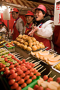 Stall selling candied fruit sticks in the Night Market, Wangfujing Street, Beijing, China
