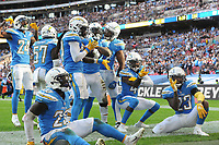 American Football - 2018 NFL Season (NFL International Series, London Games) - Tennessee Titans vs. Los Angeles Chargers<br /> <br /> Denzel Perryman of the Chargers celebrates his important tackle with his team mates, at Wembley Stadium.<br /> <br /> COLORSPORT/ANDREW COWIE