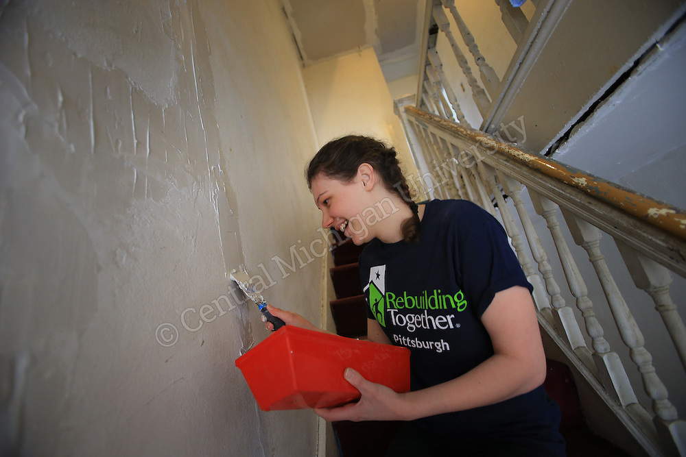 Samantha Bruck, of Monroe, works on spackling a wall on her urban renewal project. Bruck was among ten Central Michigan University students who spent their Alternative Break week volunteering with Rebuilding Together, an urban renewal experience, in Pittsburgh, PA. Their urban renewal experience gave them hands on experience working on homes and making repairs. Photo by Steve Jessmore/Central Michigan University