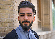 Iran, Tehran province, Tehran, young man with western haircut in the bazaar. Officials have banned styles like this, describing them as devil-worshipping and homosexual.