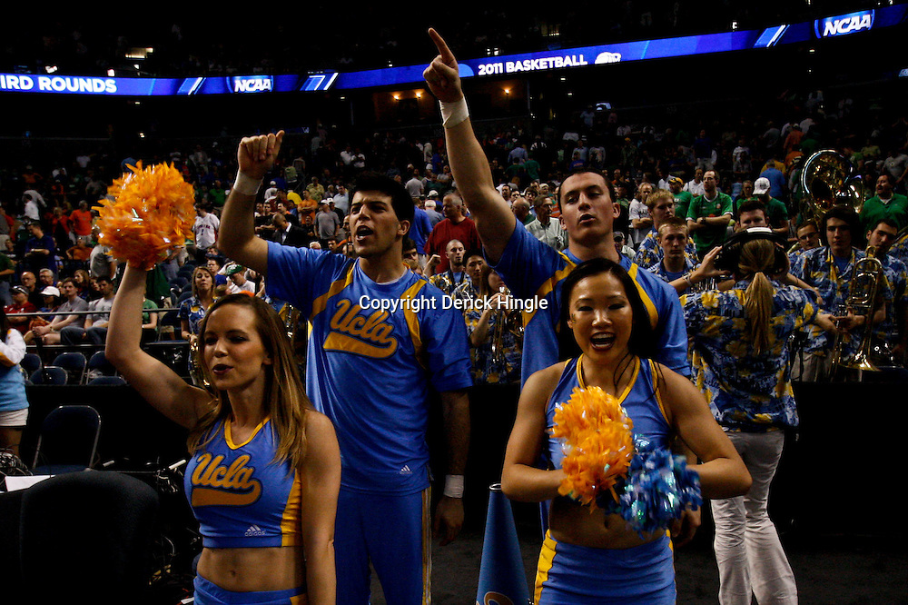 Mar 17, 2011; Tampa, FL, USA; UCLA Bruins cheerleaders at the end of the first half of the second round of the 2011 NCAA men's basketball tournament game against the Michigan State Spartans at the St. Pete Times Forum. UCLA defeated Michigan State 78-76.  Mandatory Credit: Derick E. Hingle