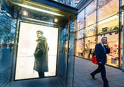 Glass display cabinet for Filippa K boutique  on famous shopping street Kurfurstendamm , Kudamm, in Berlin, Germany.