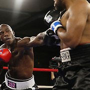 Mike Bolagun of Upper Marlboro, Maryland and Terrance Marbar of St. Pete, Florida (L) exchange blows in a heavyweight clash during a Nelsons Promotions boxing match at the Boca Raton Resort  and Club on Friday, May 26, 2017 in Boca Raton, Florida.  (Alex Menendez via AP)
