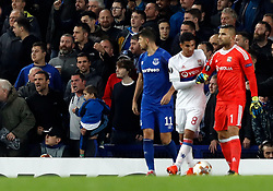 Lyon goalkeeper Anthony Lopes reacts after a fan holding a child (left) appears to have pushed and aimed a punch in the direction of himself and Lyon's Mouctar Diakhaby