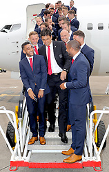 CARDIFF, WALES - Saturday, June 4, 2016: The Wales manager Chris Coleman accidentally photobombs Neil Taylor and captain Ashley Williams' selfie on the steps of the plane at Cardiff Airport as the squad head to Sweden for their last friendly before the UEFA Euro 2016 in France. (Pic by David Rawcliffe/Propaganda)