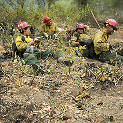 Tatanka Hotshots, a Forest Service Hotshot Crew based in Custer, SD take a break near Dog Mountain in Pine, Idaho while fighting the Elk fire. The Elk fire had burned 111,977 acres and was 10% contained as of 8am.  Wednesday August 14, 2013