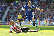 Sunderland forward Jermain Lens (17)   tackles Leicester City forward Jamie Vardy (9)  during the Barclays Premier League match between Sunderland and Leicester City at the Stadium Of Light, Sunderland, England on 10 April 2016. Photo by Simon Davies.