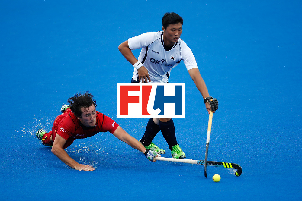 LONDON, ENGLAND - JUNE 17:  Seungju You of Korea plays and Arthur van Doren fight for the ball during the FIH Men's  Hero Hockey Champions Trophy match between Belgium and Korea at Queen Elizabeth Olympic Park on June 17, 2016 in London, England.  (Photo by Joel Ford/Getty Images)
