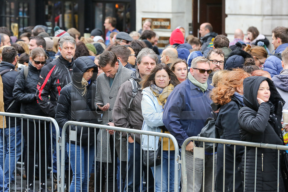 © Licensed to London News Pictures. 27/04/2019. London, UK. Long queue of voters outside High Commission of South Africa in London waiting to cast their vote in this year's general election. Over 9000 South Africans have registered to vote in the UK, which is the highest number of registered voters living abroad. The Electoral Commission has extended voting hours for South African citizens in London until 11:30 pm on Saturday night because of the Vaisakhi Festival at Trafalgar square.<br /> <br /> General elections will be held in South Africa on 8 May 2019 to elect a new National Assembly and provincial legislatures in each province<br /> <br /> Photo credit: Dinendra Haria/LNP