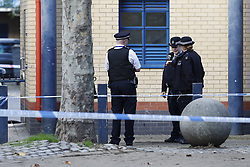 © Licensed to London News Pictures. 18/10/2018. London, UK. The scene on the Doddington estate in Battersea after a man in his 40's died after an alleged assault. Police were called at around 5.30pm to reports of several males fighting. Photo credit: Peter Macdiarmid/LNP