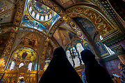 Prayers inside an orthodox church.