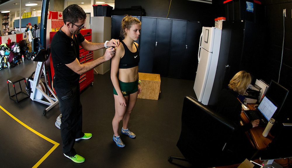 Trent Stellingwerff, applied sport physiologist with a specialization in performance nutrition performs anthropometric measurements on Erin Teschuk at the Pacific Institute for Sport Excellence on December 3rd 2015 in Victoria, British Columbia Canada.