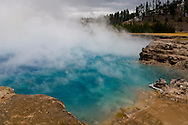 Geothermal steam rising out of Excelsior Geyser Crater, Midway Geyser Basin, Yellowstone National Park, Wyoming