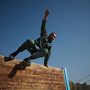 November 14, 2012 - Kabul, Afghanistan: An Afghan National Police (ANP) cadet jumps an obstacle during morning endurance exercises at the Afghan Nacional Police Academy...ANP Academy trains 1250 cadets at the time during a period of four years. Every year, five hundred new recruits are selected, out of more than nine thousand of candidates, to join the academy and other five hundred graduate. Fifteen per cent of the recruits are women. (Paulo Nunes dos Santos)