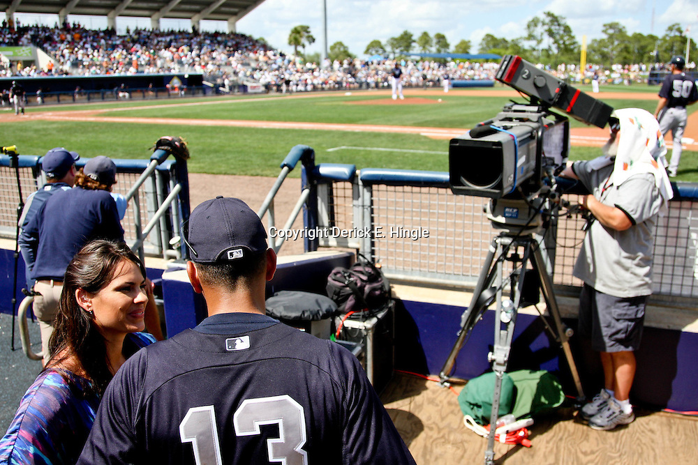 March 21, 2012; Port Charlotte, FL, USA; ESPN reporter Jessica Mendoza interviews New York Yankees third baseman Alex Rodriguez (13) during the in the dugout during a spring training game between the Tampa Bay Rays and the New York Yankees at Charlotte Sports Park.  Mandatory Credit: Derick E. Hingle-US PRESSWIRE