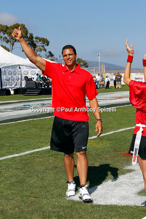 Former Kansas City Chiefs and Atlanta Falcons tight end Tony Gonzalez waves to fans as he coaches the Gamers team during the EA Sports Madden NFL 11 Launch celebrity and NFL player flag football game held at Malibu Bluffs State Park on July 22, 2010 in Malibu, California. (©Paul Anthony Spinelli)