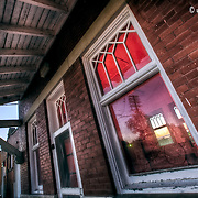 Old train depot in Stafford Kansas at sunset, late summer 2010.