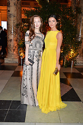 Left to right, OLIVIA GRANT and LUCY MECKLENBURGH at the inaugural dinner for The Queen Elizabeth Scholarship Trust hosted by Viscount Linley at the V&A museum, London on 25th February 2016.
